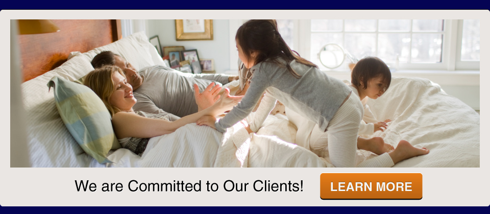 We are Committed to Our Clients, Call us today; Family on bed